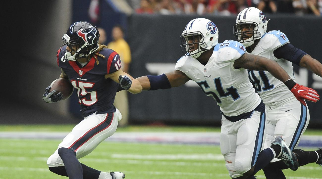 Houston Texans wide receiver Will Fuller (15) is chased by Tennessee Titans inside linebacker Avery Williamson (54) after a reception during the first half of an NFL football game, Sunday, Oct. 2, 2016, in Houston. (AP Photo/George Bridges)