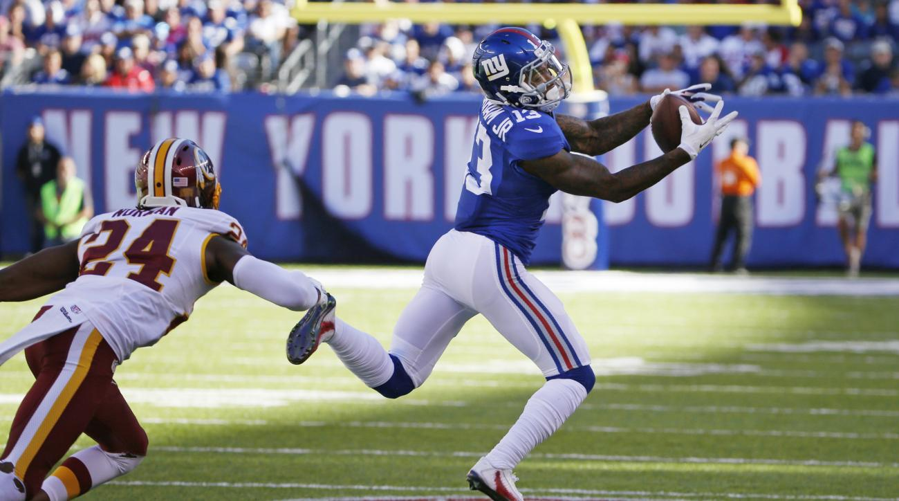 FILE - In this Sunday, Sept. 25, 2016, file photo, New York Giants wide receiver Odell Beckham (13) catches a pass in front of Washington Redskins' Josh Norman (24) during the second half of an NFL football game in East Rutherford, N.J. Maybe Beckham will