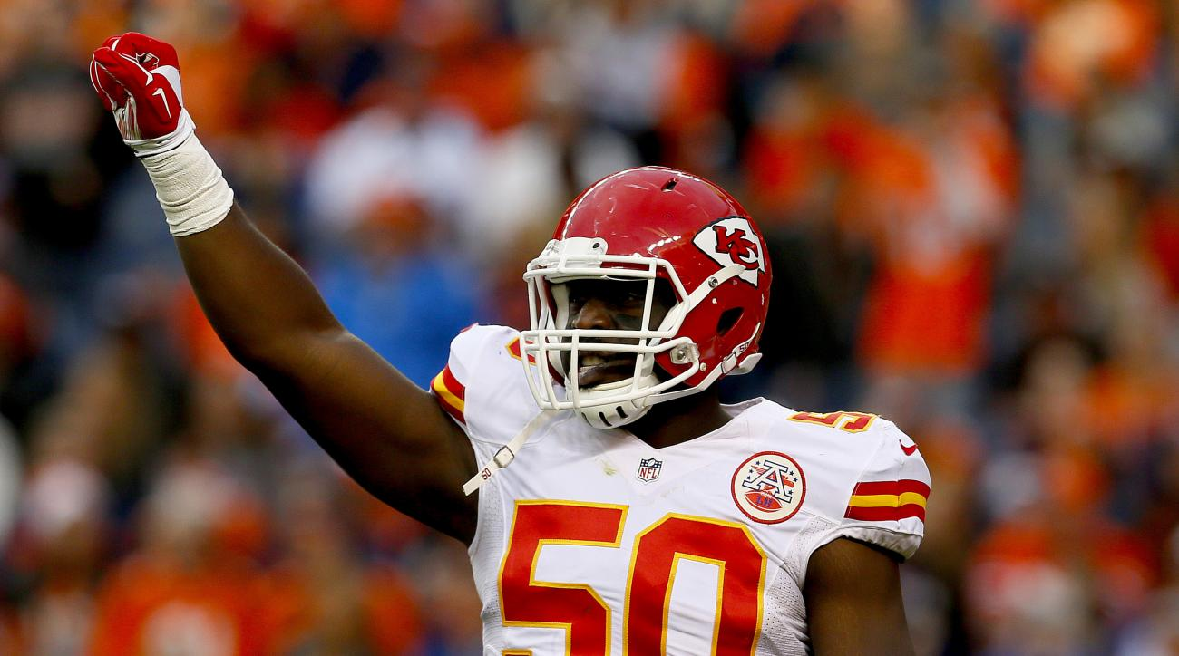 FILE - In this Nov. 15, 2015, file photo, Kansas City Chiefs outside linebacker Justin Houston (50) celebrates a stop during the second half of an NFL football game against the Denver Broncos in Denver. Houston has been cleared to resume football activity