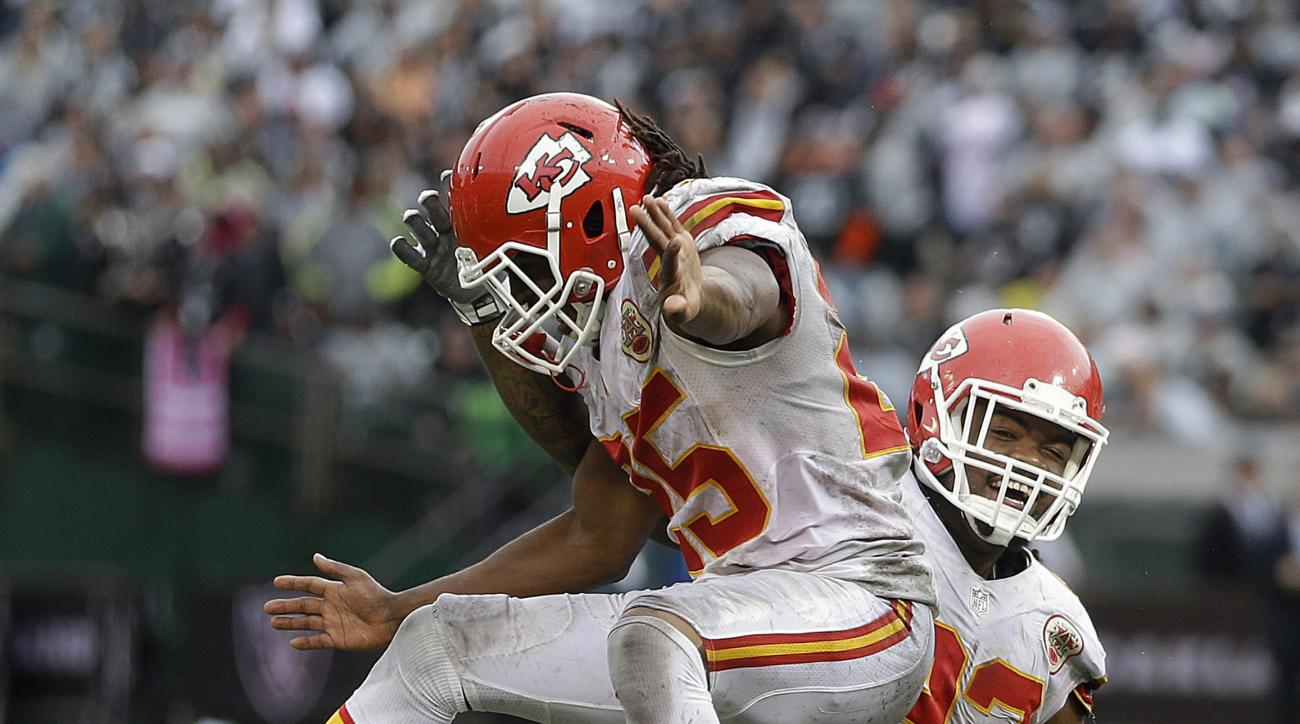 Kansas City Chiefs nose tackle Dontari Poe, right, celebrates after catching a touchdown pass with running back Jamaal Charles during the second half of an NFL football game against the Oakland Raiders in Oakland, Calif., Sunday, Oct. 16, 2016. (AP Photo/