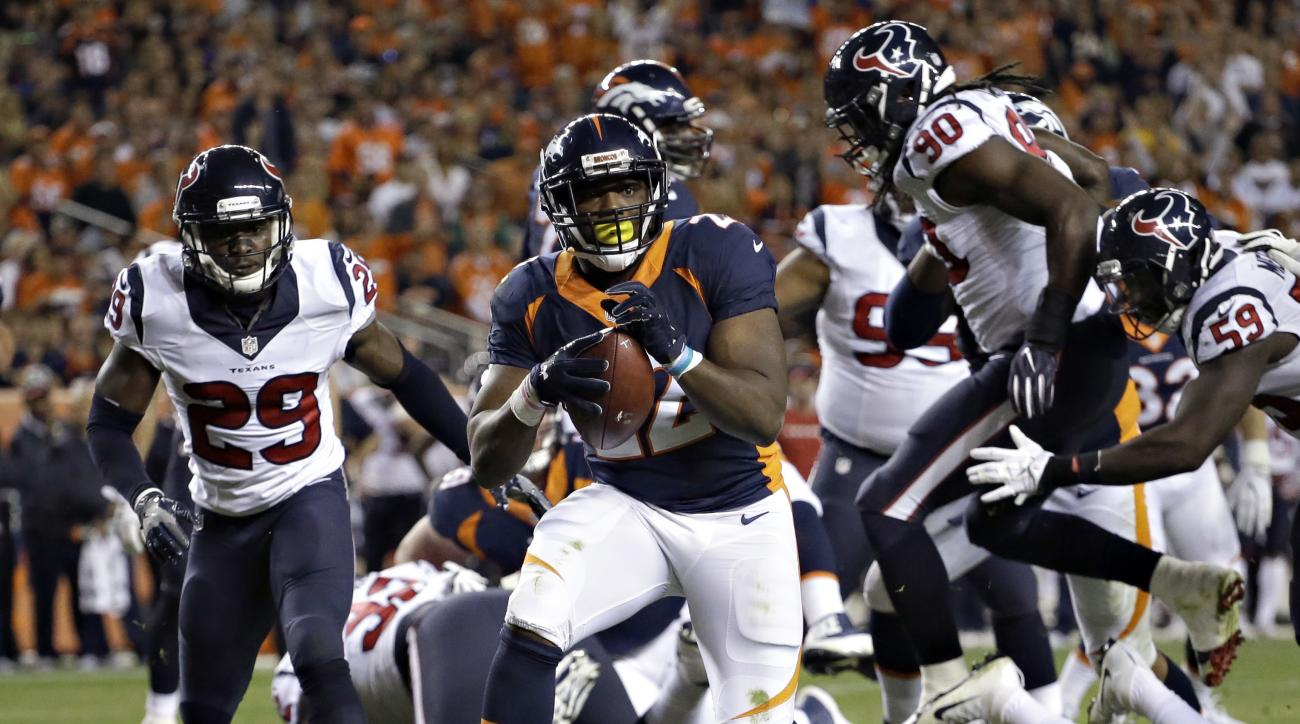Denver Broncos running back C.J. Anderson (22) scores a touchdown against the Houston Texans during the first half of an NFL football game, Monday, Oct. 24, 2016, in Denver. (AP Photo/Jack Dempsey)