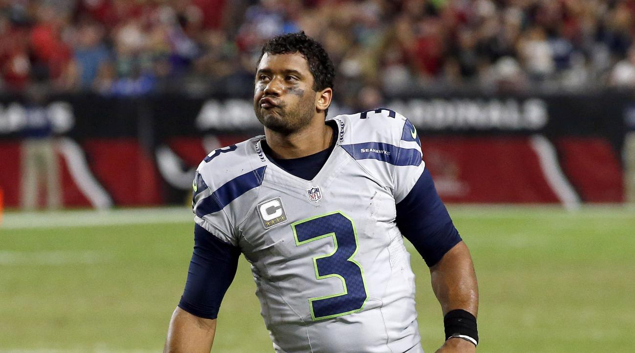 FILE - In this Oct. 23, 2016, file photo, Seattle Seahawks quarterback Russell Wilson (3) reacts after a missed game-winning field goal attempt during overtime of an NFL football game against the Arizona Cardinals, in Glendale, Ariz. Russell Wilson has ce