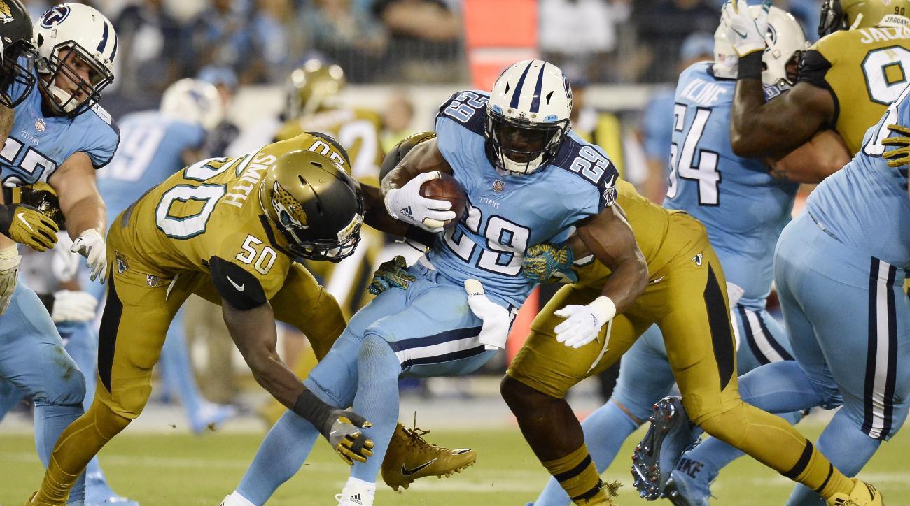 Tennessee Titans running back DeMarco Murray (29) is stopped by Jacksonville Jaguars linebacker Telvin Smith (50) and defensive end Dante Fowler, right, in the first half of an NFL football game Thursday, Oct. 27, 2016, in Nashville, Tenn. (AP Photo/Mark
