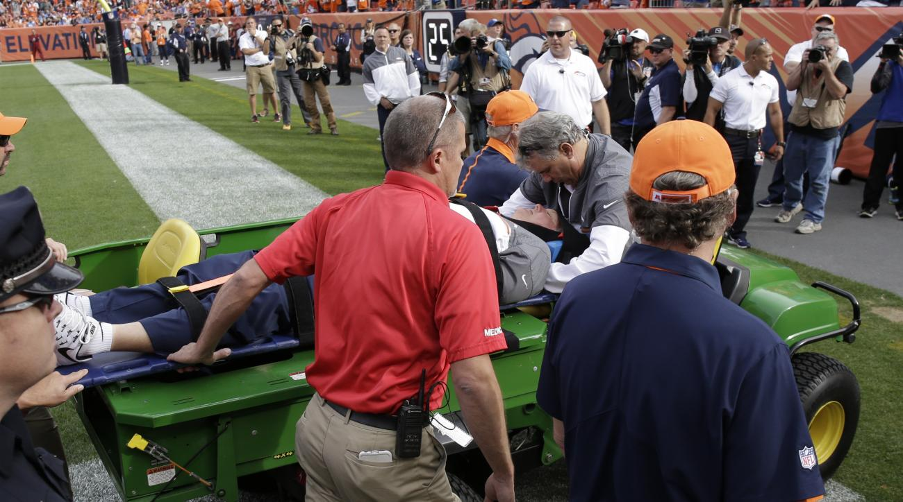 Denver Broncos offensive coordinator Wade Phillips is carted off the field after being run into by a player while on standing on the sidelines during the first half of an NFL football game against the San Diego Chargers, Sunday, Oct. 30, 2016, in Denver.