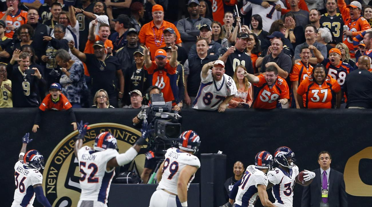 Denver Broncos defensive back Will Parks  celebrates in the end zone with teammates after returning a blocked extra point for a safety in the second half of an NFL football game against the New Orleans Saints in New Orleans, Sunday, Nov. 13, 2016. The Bro