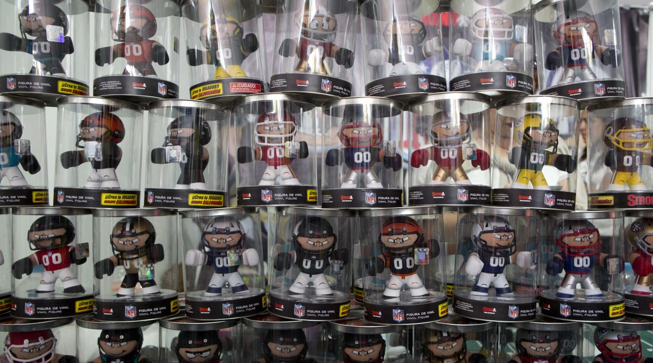 In this Nov. 6, 2016 photo, statuetes of players from American football teams stand for sale at the third annual American Football Expo in Mexico City. Local football historian Alejandro Morales, who also created Mexicos football hall of fame, said the fi
