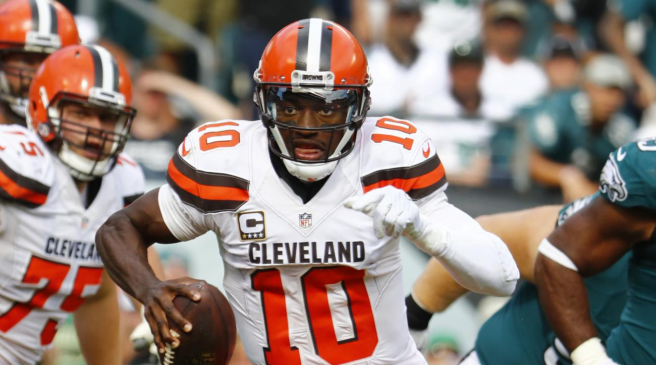 FILE - In this Sept. 11, 2016, file photo, Cleveland Browns quarterback Robert Griffin III runs the ball against the Philadelphia Eagles in Philadelphia. Griffin moved closer to playing again this season as the team designated him for return from injured