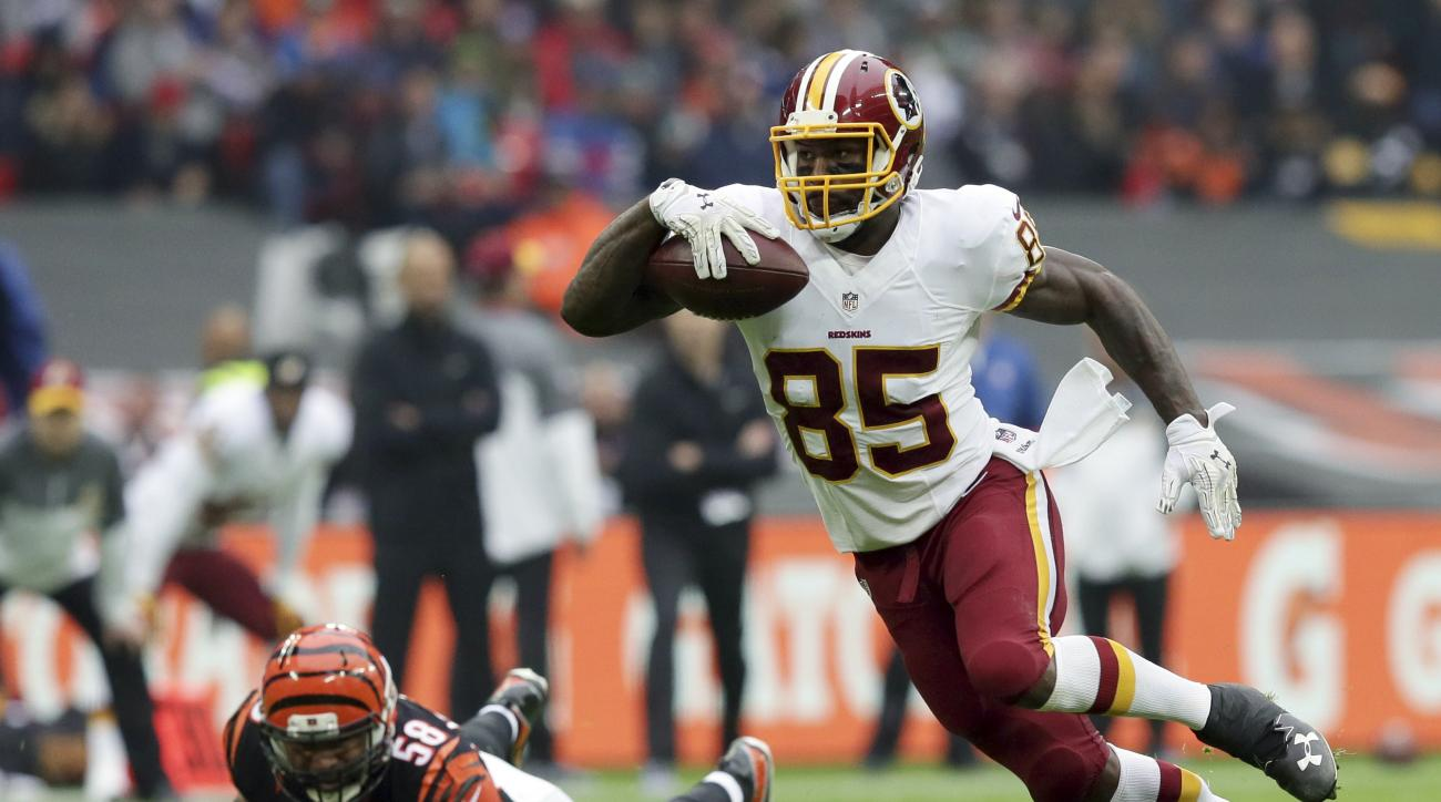 FILE - In this Oct. 30, 2016 photo, Washington Redskins tight end Vernon Davis (85) runs with the ball during an NFL Football game between Cincinnati Bengals and Washington Redskins at Wembley Stadium in London. After the 49ers and Broncos didnt want him,