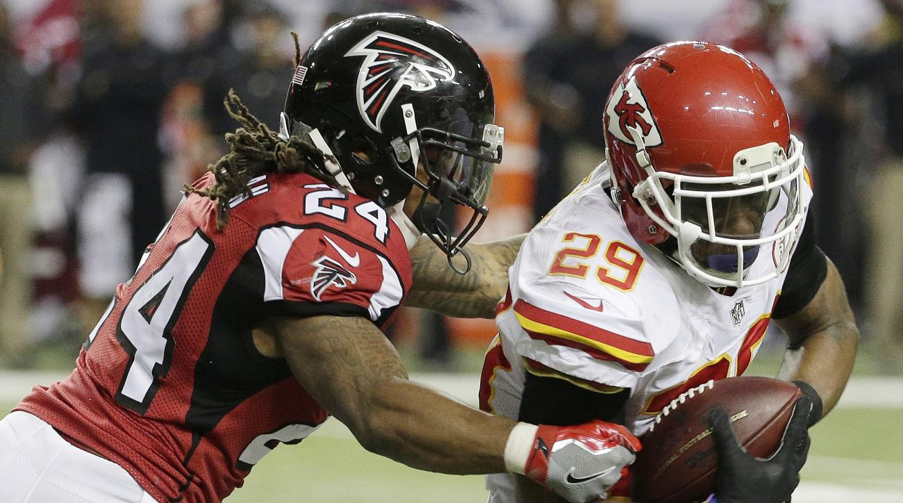 Kansas City Chiefs strong safety Eric Berry (29) breaks the tackle of Atlanta Falcons running back Devonta Freeman (24) after Berry made an interception during the first half of an NFL football game, Sunday, Dec. 4, 2016, in Atlanta. Berry scored a touchd