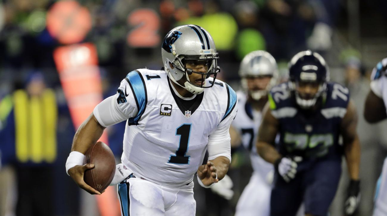 Carolina Panthers quarterback Cam Newton runs with the ball against the Seattle Seahawks in the first half of an NFL football game, Sunday, Dec. 4, 2016, in Seattle. (AP Photo/Stephen Brashear)