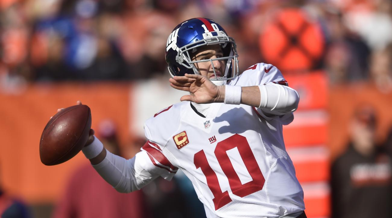 FILE  - In this Sunday, Nov. 27, 2016 file photo, New York Giants quarterback Eli Manning throws in the first half of an NFL football game against the Cleveland Browns in Cleveland. The Lions are riding a five-game winning streak that has given them a two