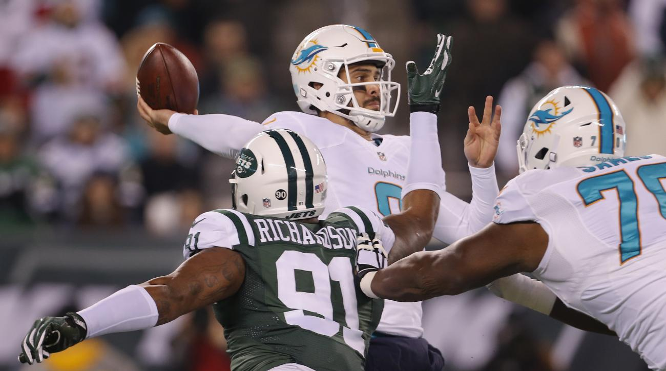 Miami Dolphins quarterback Matt Moore (8) throws under pressure from New York Jets defensive end Sheldon Richardson (91) during the second quarter of an NFL football game, Saturday, Dec. 17, 2016, in East Rutherford, N.J. (AP Photo/Adam Hunger)
