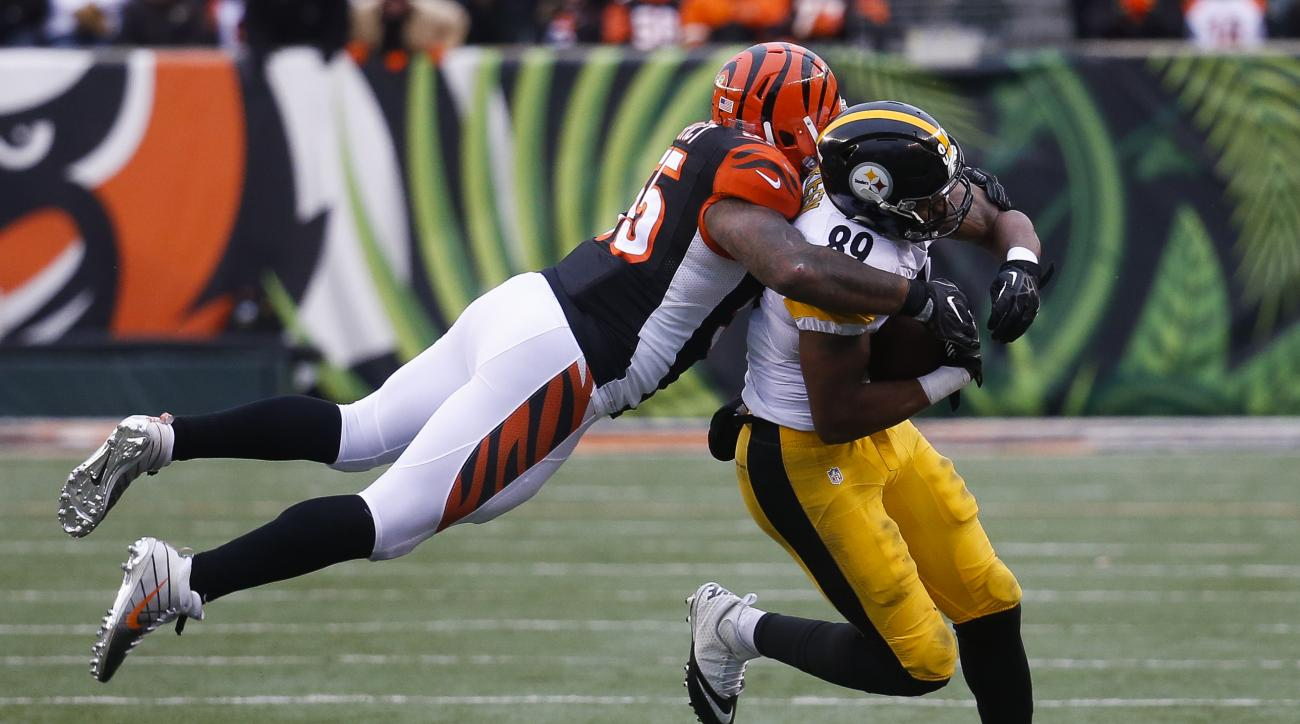 Cincinnati Bengals outside linebacker Vontaze Burfict (55) leaps to tackle Pittsburgh Steelers tight end Ladarius Green (89) in the second half of an NFL football game, Sunday, Dec. 18, 2016, in Cincinnati. (AP Photo/Frank Victores)