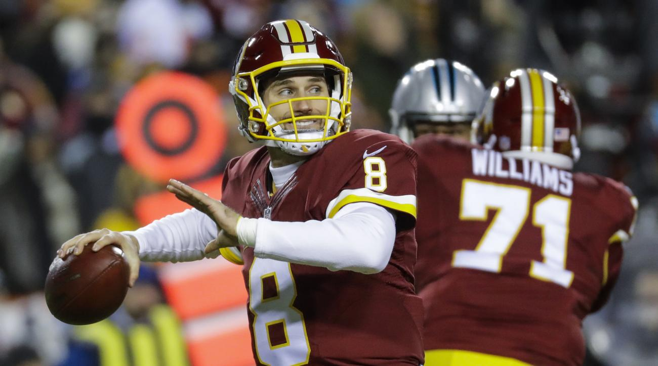 Washington Redskins quarterback Kirk Cousins (8) passes the ball during the first half of an NFL football game against the Carolina Panthers in Landover, Md., Monday, Dec. 19, 2016. (AP Photo/Patrick Semansky)