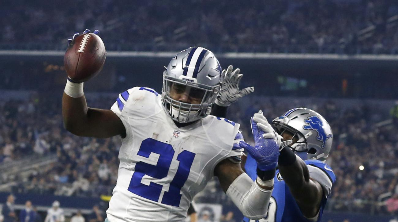 Dallas Cowboys' Ezekiel Elliott (21) leaps into the end zone after getting past Detroit Lions' Tahir Whitehead, rear, for a touchdown in the second half of an NFL football game, Monday, Dec. 26, 2016, in Arlington, Texas. (AP Photo/Michael Ainsworth)