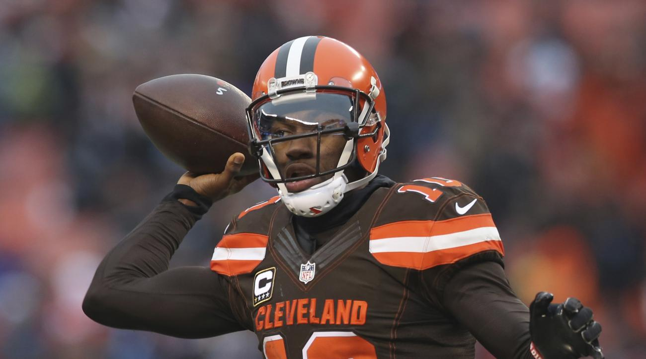 FILE - In a Saturday, Dec. 24, 2016 file photo, Cleveland Browns quarterback Robert Griffin III (10) throws a pass to Isaiah Crowell in the second half of an NFL football game against the San Diego Chargers, in Cleveland. Griffin III remains in concussion