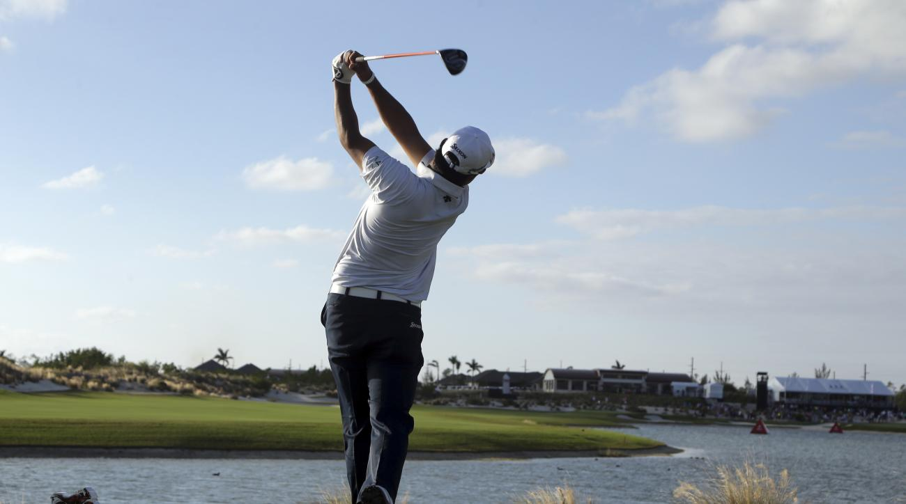 Hideki Matsuyama, of Japan, tees off from the 18th hole during the final round at the Hero World Challenge golf tournament, Sunday, Dec. 4, 2016, in Nassau, Bahamas. Matsuyama won the tournament. (AP Photo/Lynne Sladky)