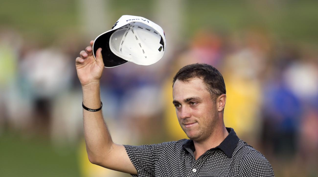 FILE - In this Jan. 15, 2017, file photo, Justin Thomas acknowledges to the gallery after winning the Sony Open golf tournament in Honolulu. Thomas is set to play in the Waste Management Phoenix Open this week, coming off a two-break after a dominating Ha