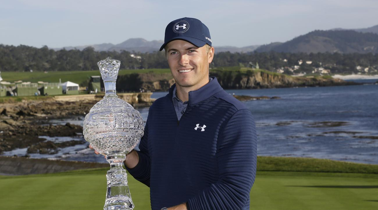 Jordan Spieth poses with his trophy on the 18th green of the Pebble Beach Golf Links after winning the AT&T Pebble Beach National Pro-Am golf tournament Sunday, Feb. 12, 2017, in Pebble Beach, Calif. (AP Photo/Eric Risberg)