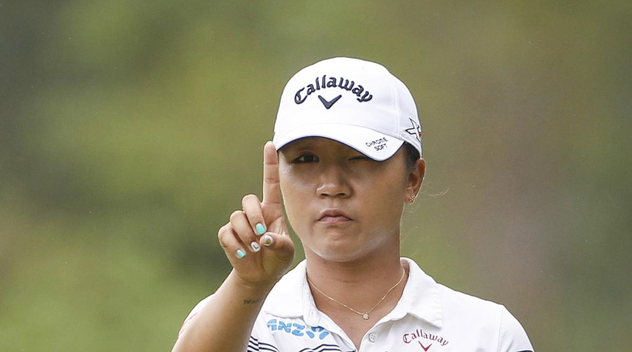 FILE - In this Oct. 28, 2016 file photo, Lydia Ko of New Zealand checks her line on the eleventh green during the second round of the LPGA golf tournament at Tournament Players Club (TPC) in Kuala Lumpur, Malaysia. A day ahead of the start of the Women's