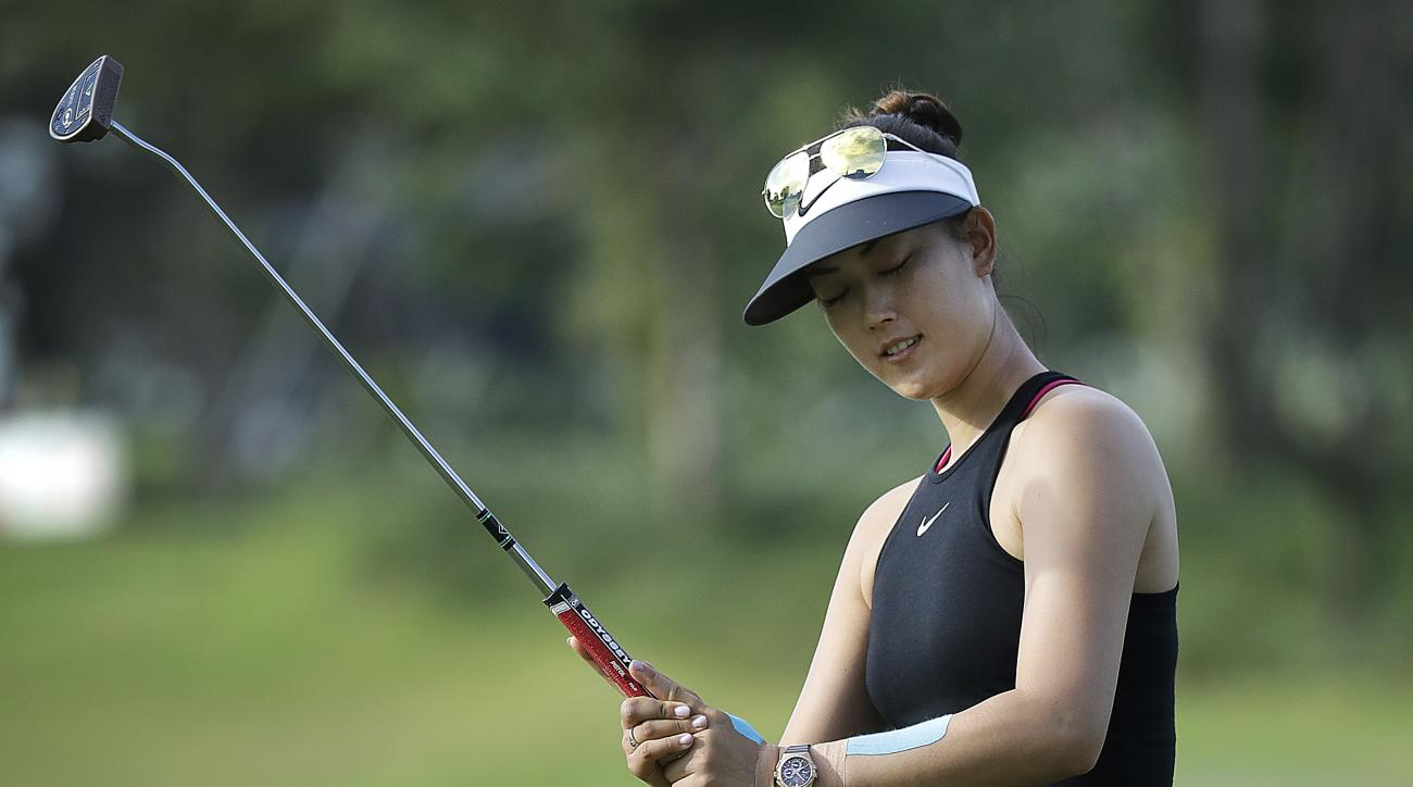 Michelle Wie of the United States reacts after failing to sink her putt on the first hole during the HSBC Women's Champions golf tournament held at Sentosa Golf Club's Tanjong course on Thursday, March 2, 2017, in Singapore. (AP Photo/Wong Maye-E)