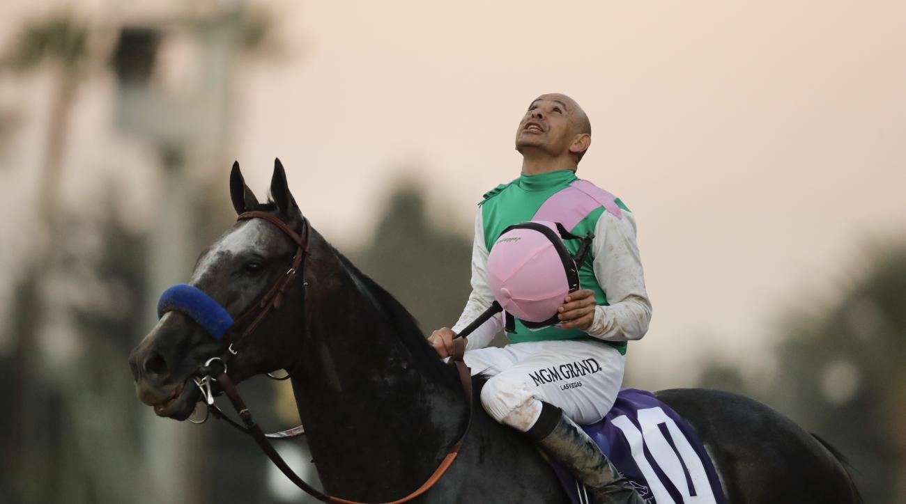 FILE - In this Nov. 5, 2016, file photo, jockey Mike Smith celebrates after riding Arrogate to victory in the Breeders' Cup Classic horse race at Santa Anita Park in Arcadia, Calif. Hall of Fame jockey Mike Smith will ride Arrogate against favored Califor
