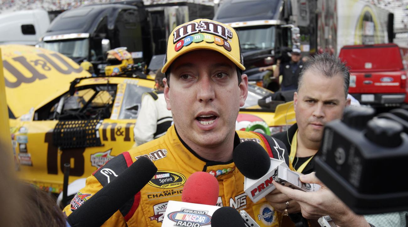 Kyle Busch speaks to media after crashing during a NASCAR Sprint Cup Series auto race, Sunday, Aug. 21, 2016 in Bristol, Tenn. The race was delayed Saturday night due to severe weather. (AP Photo/Wade Payne)