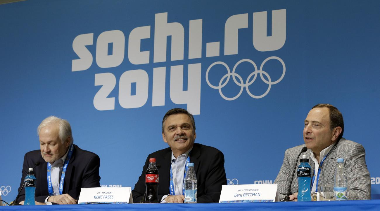 FILE - In this Feb. 18, 2014, file photo, NHL Players' Association Executive Director Don Fehr, left, International Ice Hockey Federation President Rene Fasel, center, and NHL Commissioner Gary Bettman, right, answer questions during a news conference at