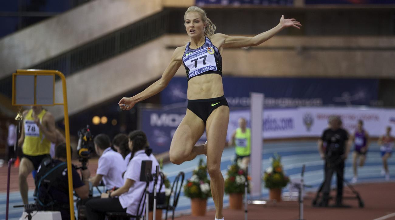 Long jumper Daria Klishina competes at the Russian Winter national athletics meet in Moscow, Russia, Sunday, Feb. 5, 2017. On Monday, track's world governing body, the IAAF, will hold a council meeting with the stated aim of drawing up a road map for Russ