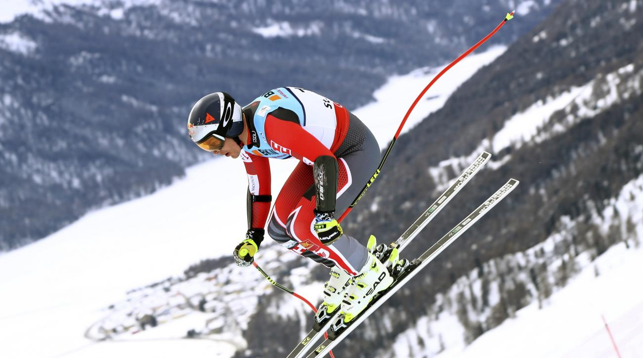 Canada's Erik Guay is airborne during a men's super-G, at the alpine ski World Championships, in St. Moritz, Switzerland, Wednesday, Feb. 8, 2017. (AP Photo/Alessandro Trovati)