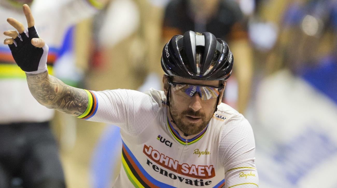 FILE - In this Sunday, Nov. 20, 2016 file photo, former Tour de France winner and Olympic Gold medalist Britain's Bradley Wiggins greets spectators prior to competing in the six day race at the Kuipke velodrome in Ghent, Belgium. An anti-doping investigat