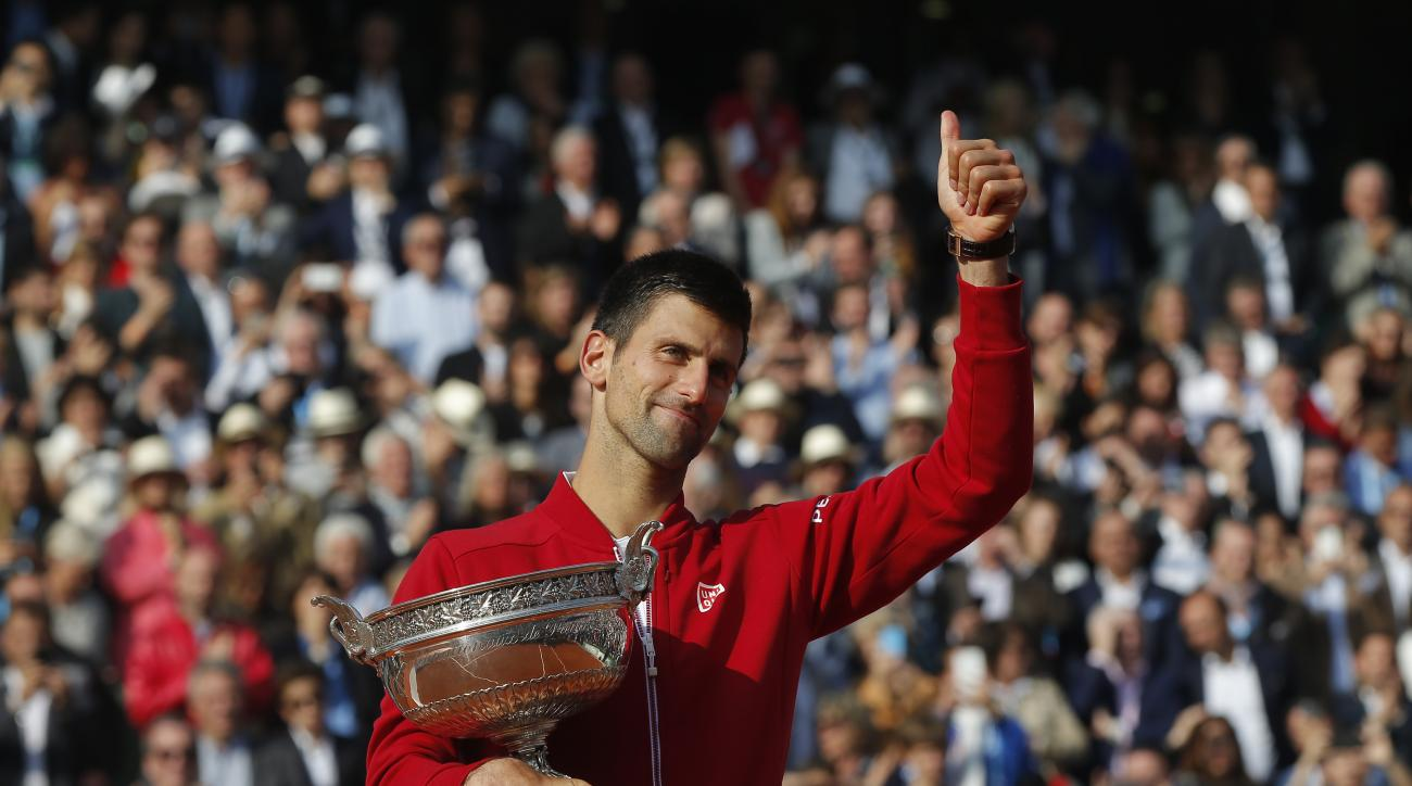 FILE - In this Sunday, June 5, 2016 file photo, Serbia's Novak Djokovic holds the trophy after winning the final of the French Open tennis tournament against Britain's Andy Murray, at the Roland Garros stadium in Paris, France. Novak Djokovic on Friday, S