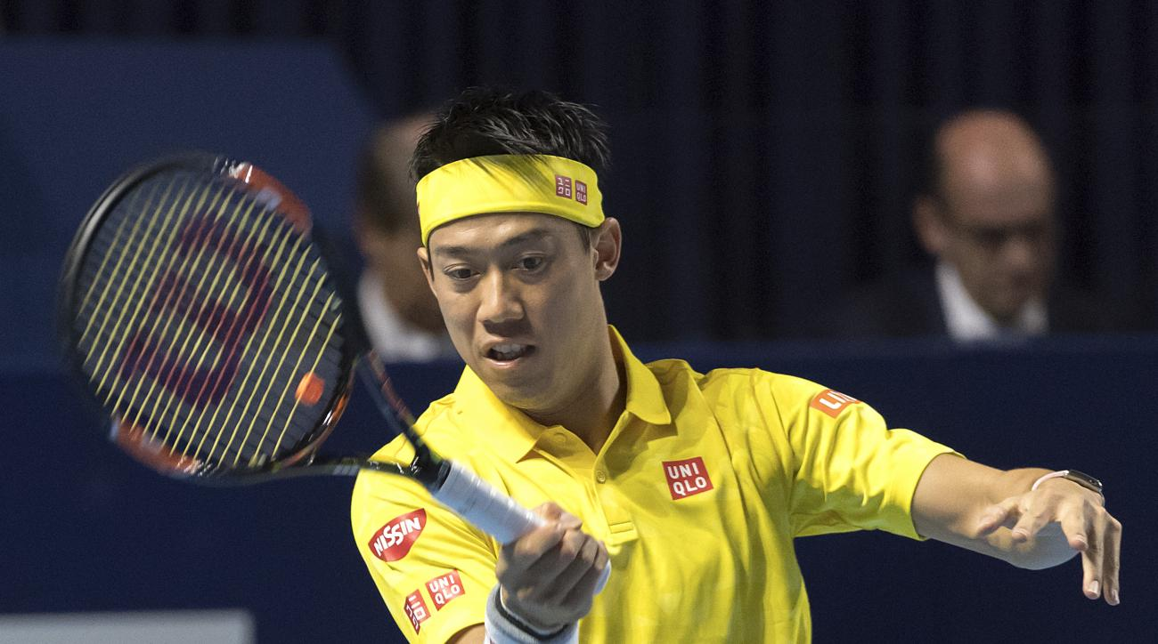 Japan's Kei Nishikori returns a ball to Italy's Paolo Lorenzi during their second round match at the Swiss Indoors tennis tournament at the St. Jakobshalle in Basel, Switzerland, Wednesday, Oct. 26, 2016. (Georgios Kefalas/Keystone via AP)
