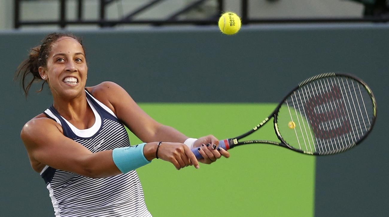 FILE - In this March 30, 2016, file photo, Madison Keys, of the United States, returns the ball against Angelique Kerber, of Germany, at the Miami Open tennis tournament in Key Biscayne, Fla. Keys says she will miss the Australian Open after having wrist