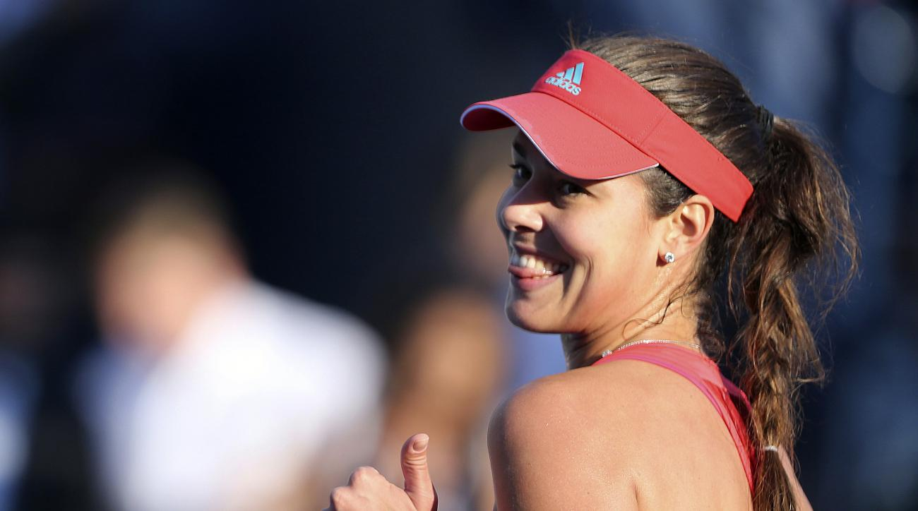 FILE - In this Tuesday, Feb. 16, 2016 file photo, Ana Ivanovic from Serbia celebrates after she beat Daria Gavrilova from Australia during the second day of the Dubai Tennis Championships in Dubai, United Arab Emirates. Ana Ivanovic is retiring from tenni