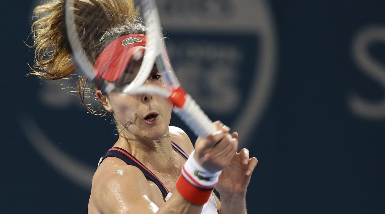 Alize Cornet of France plays a shot in her final match against Karolina Pliskova of the Czech Republic at the Brisbane International tennis tournament in Brisbane, Australia, Saturday, Jan. 7, 2017. (AP Photo/Tertius Pickard)