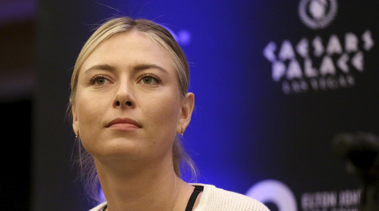 FILE - In this Monday, Oct. 10, 2016 file photo, Maria Sharapova speaks to members of the media prior to a World Team Tennis exhibition in Las Vegas, U.S. Sharapova will return from her 15-month doping ban at a tournament in Germany in April. (AP Photo/Is