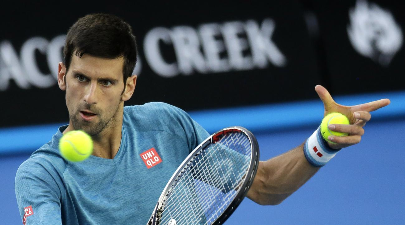 Serbia's Novak Djokovic makes a backhand return during a practice session ahead of the Australian Open tennis championships in Melbourne, Australia, Sunday, Jan. 15, 2017. (AP Photo/Aaron Favila)