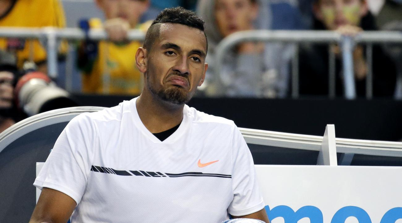 Australia's Nick Kyrgios reacts while sitting in his chair during his second round match against Italy's Andreas Seppi at the Australian Open tennis championships in Melbourne, Australia, Wednesday, Jan. 18, 2017. (AP Photo/Aaron Favila)