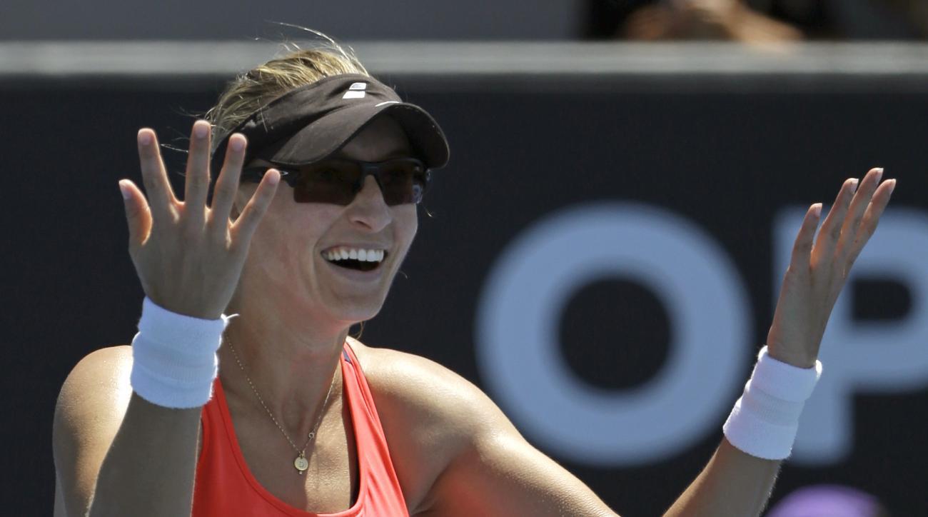 Croatia's Mirjana Lucic-Baroni celebrates after defeating Maria Sakkari of Greece in their third round match at the Australian Open tennis championships in Melbourne, Australia, Saturday, Jan. 21, 2017. (AP Photo/Dita Alangkara)