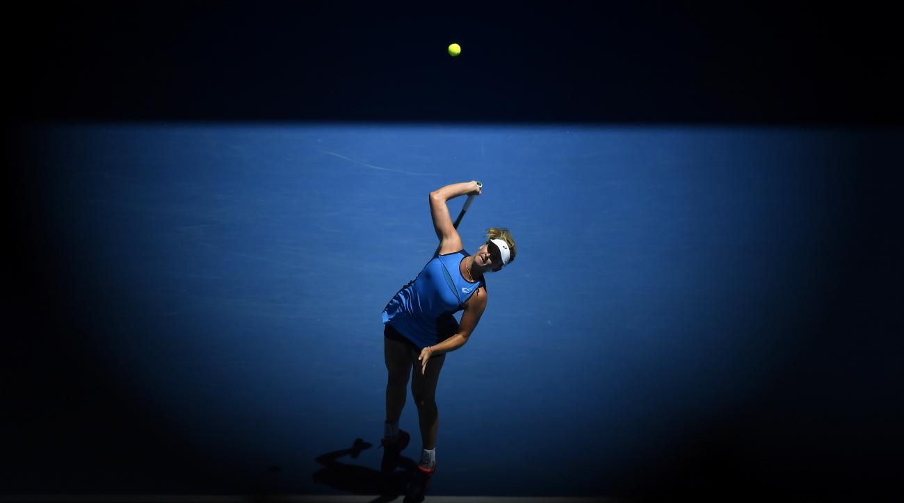 United States' Coco Vandeweghe serves to Spain's Garbine Muguruza during their quarterfinal at the Australian Open tennis championships in Melbourne, Australia, Tuesday, Jan. 24, 2017. (AP Photo/Andy Brownbill)