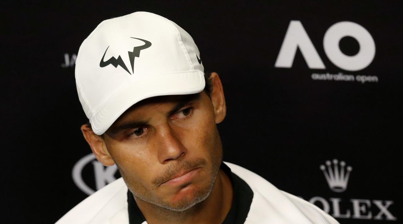 Spain's Rafael Nadal answers question at press conference following his loss to Switzerland's Roger Federer in the men's singles final at the Australian Open tennis championships in Melbourne, Australia, early Monday, Jan. 30, 2017. (AP Photo/Kin Cheung)