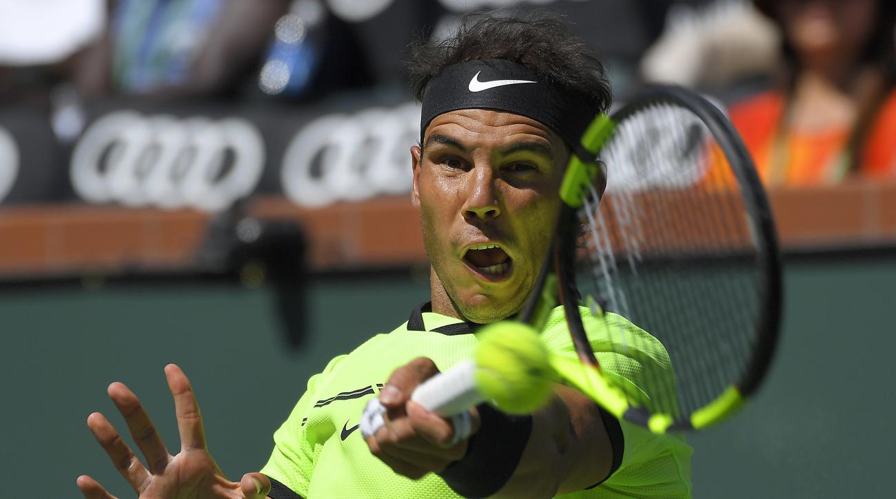 Rafael Nadal, of Spain, returns a shot to Fernando Verdasco, of Spain, at the BNP Paribas Open tennis tournament, Tuesday, March 14, 2017, in Indian Wells, Calif. (AP Photo/Mark J. Terrill)
