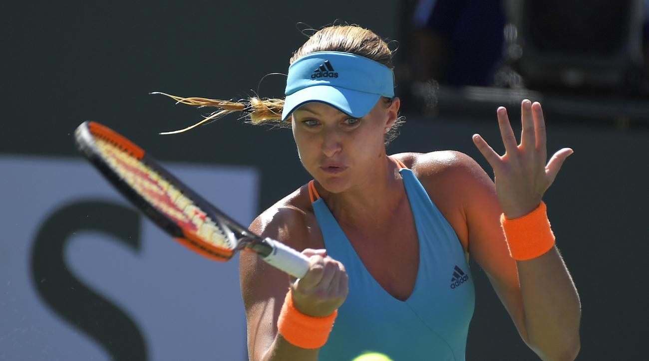 Kristina Mladenovic, of France, returns a shot to Caroline Wozniacki, of Denmark, at the BNP Paribas Open tennis tournament, Thursday, March 16, 2017, in Indian Wells, Calif. (AP Photo/Mark J. Terrill)