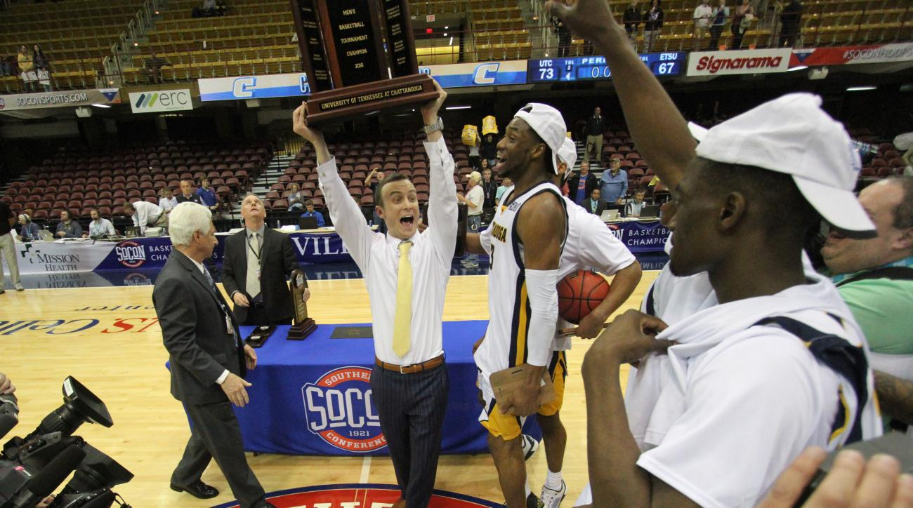 Chattanooga head coach Matt McCall celebtrates with his team after winning the championship game of the NCAA men's Southern Conference basketball tournament against East Tennessee State University in Asheville, N.C., Monday, March 7, 2016. (AP Photo/Ben E