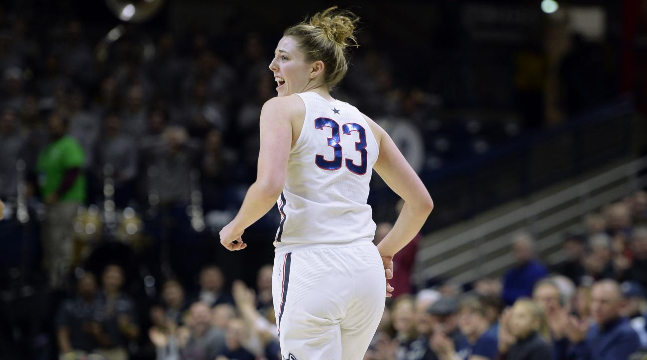 Connecticut's Katie Lou Samuelson smiles as she runs upcourt after scoring a basket against Tulsa in the second of an NCAA college basketball game, Sunday, Feb. 5, 2017, in Storrs, Conn. (AP Photo/Jessica Hill)