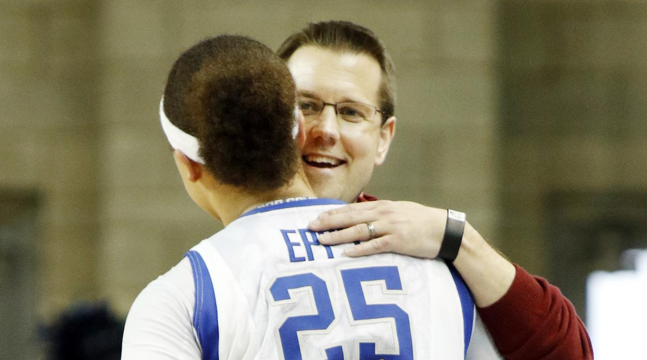 Kentucky's Makayla Epps (25) receives a hug from Belmont head coach Cameron Newbauer after a first-round game in the women's NCAA college basketball tournament in Lexington, Ky., Friday, March 17, 2017. Kentucky won 73-70. (AP Photo/James Crisp)