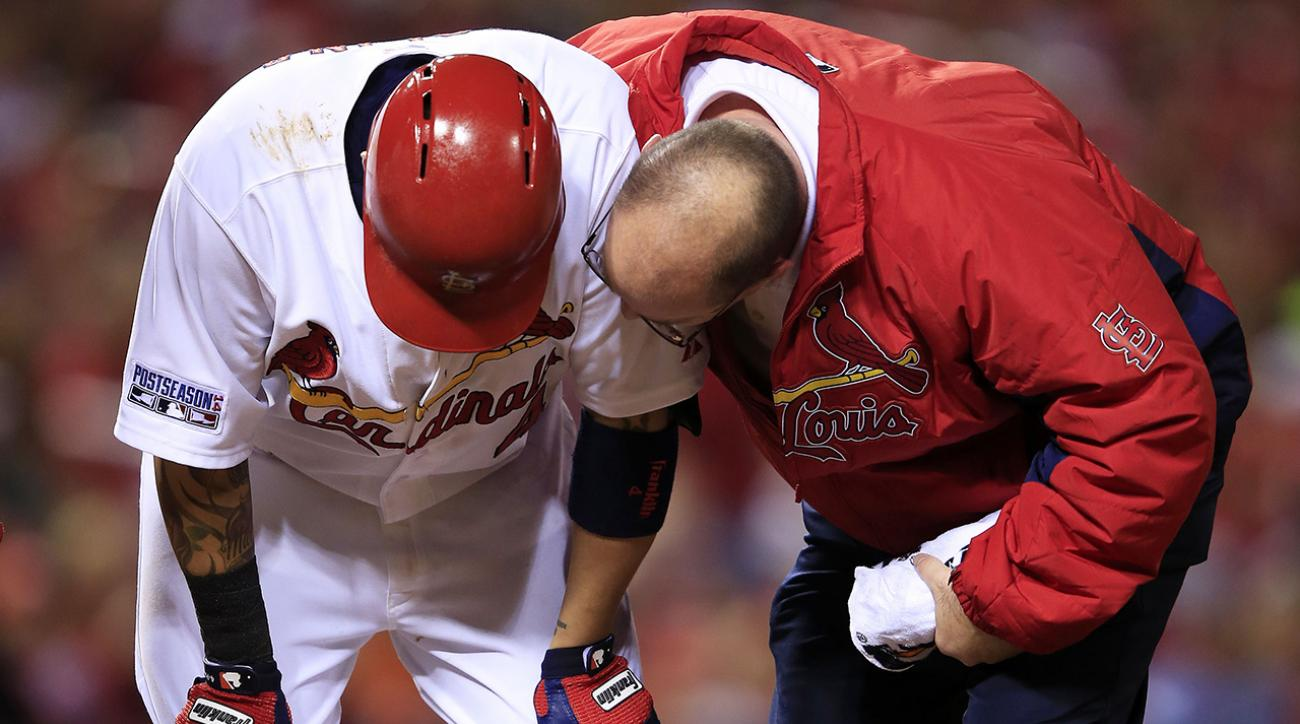 St. Louis Cardinals catcher Yadier Molina strained his left oblique during a 6th inning at-bat in Game 2 of the NLCS.