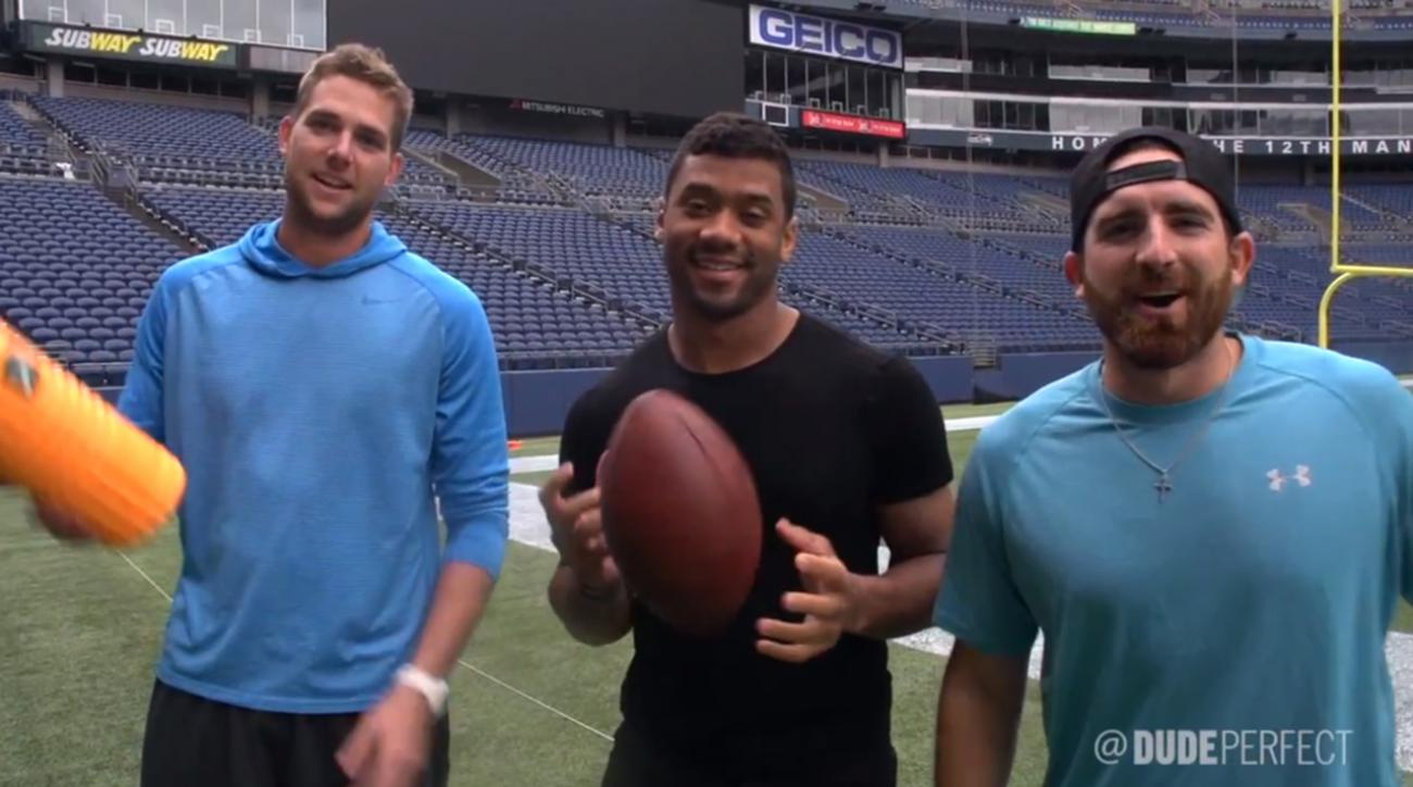 Watch: Russell Wilson, Pete Carroll star in new trick shot video