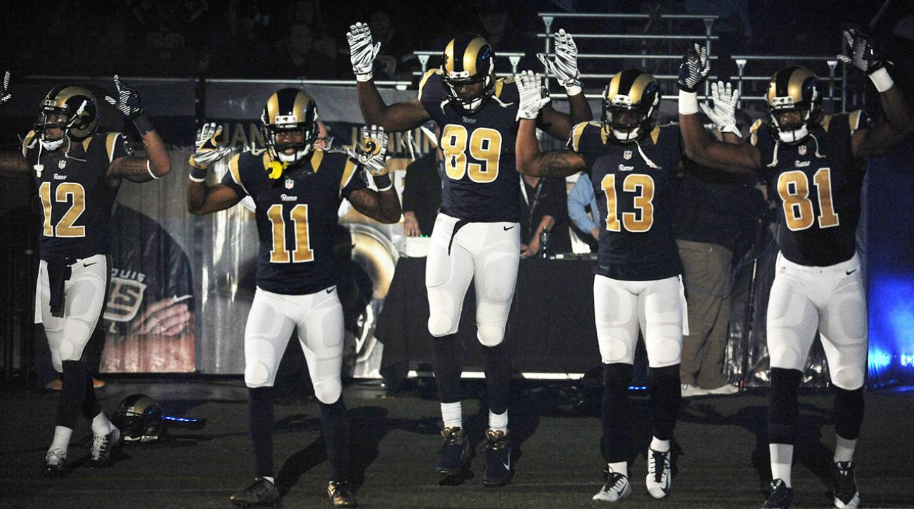 Rams players use 'hands up, don't shoot' pose in pregame